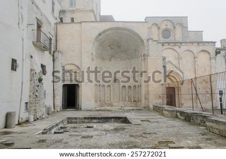 Abandoned ancient romanic apse close Rotari's tomb, Monte Sant'angelo - stock photo