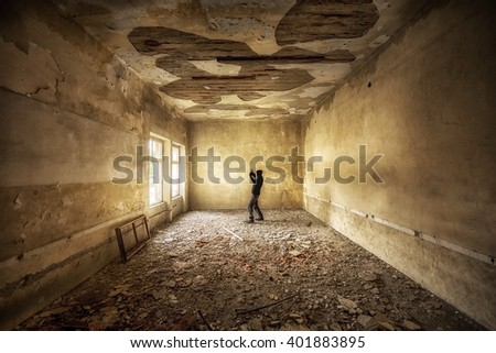 Abandoned and desolate interior of social building - stock photo