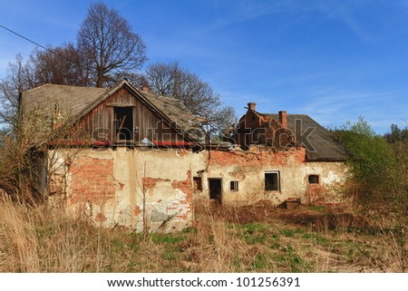 abandoned and dilapidated farm - stock photo