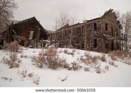 Abandoned and dilapidated hotel in a Montana ghost town - stock photo