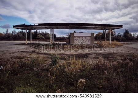 Abandoned and overgrown gas station
