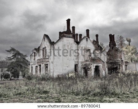 Abandoned and ruined house in Russia. - stock photo