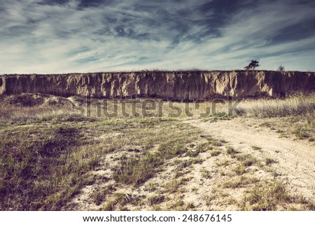 abandoned and unmaintained landscape hot  summer day - stock photo