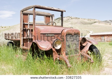 Abandoned antique International truck in the  ghost town at Bannack State Park, Montana - stock photo