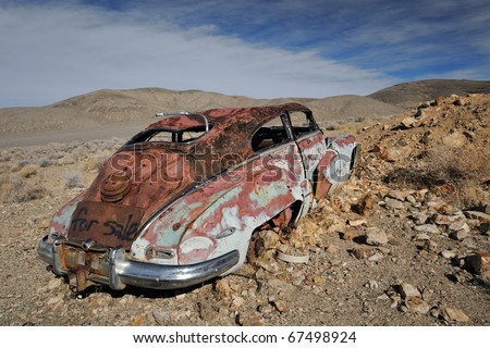 Abandoned automobile at the Aguereberry Camp in Death Valley National Park, California - stock photo