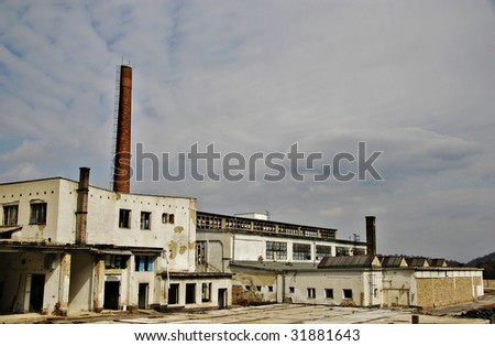 abandoned bankrupted factory with text space - stock photo