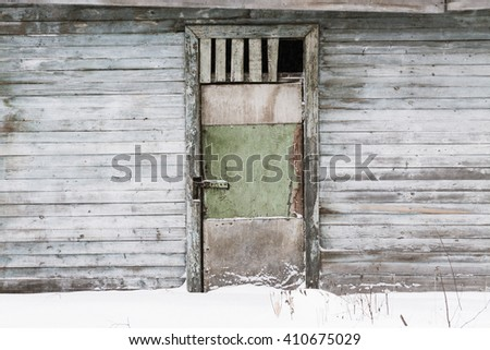 abandoned barn with an interesting texture of the wall - stock photo