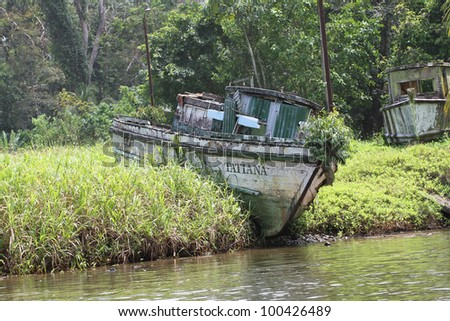abandoned boat in a fishing creek - stock photo