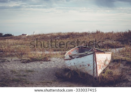 Abandoned boat sits on a beach in the morning near Port Townsend, WA USA.  - stock photo