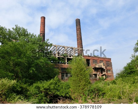 Abandoned brick factory warehouse exterior - landscape color photo - stock photo