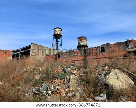 Abandoned brick warehouse in Detroit with blue sky - landscape photo - stock photo