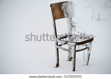 Abandoned Broken Down Old Wooden Chair In The Winter Nature