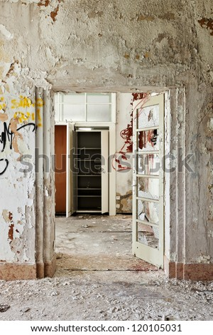 abandoned building, door broken - stock photo
