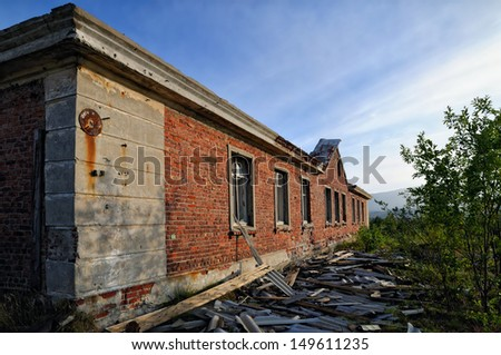 Abandoned building from a red brick - stock photo