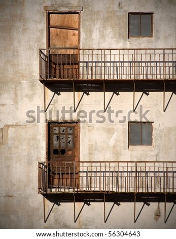 Abandoned building in NYC with two rusty doors - stock photo