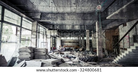 Abandoned building interior. Corridor perspective with dirt and damages. Vintage tonal photo filter effect and concrete texture layer - stock photo