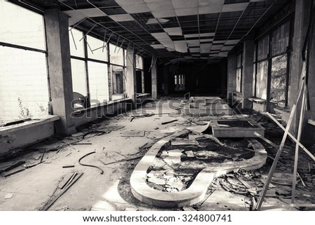 Abandoned building interior. Corridor perspective with many damages. Vintage monochrome toned photo, old style - stock photo
