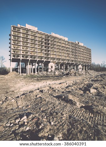 abandoned building ruins on blue sky - vintage effect - stock photo
