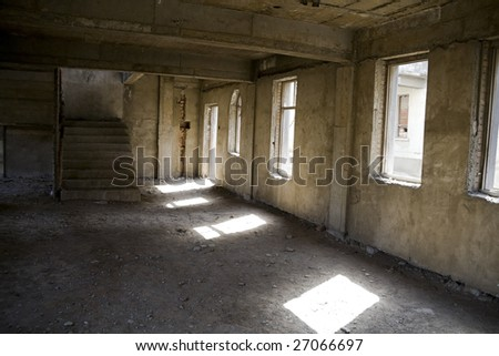 abandoned building with sunlight filling on city