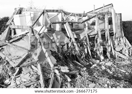 Abandoned buildings destroyed In order for new building, B&W - stock photo