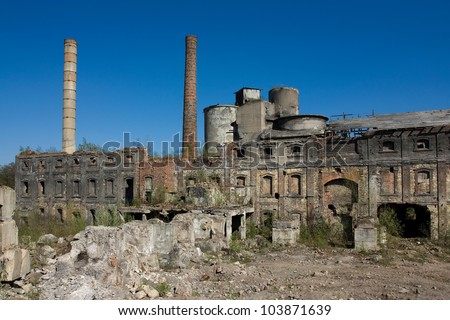 abandoned buildings, industrial ruins on blue sky background - stock photo