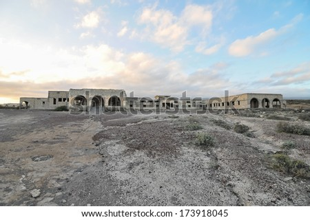 Abandoned Buildings of a Military Base at Sunset - stock photo