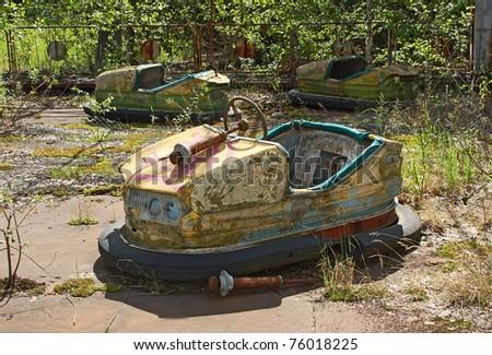 Abandoned car in amusement park in Pripyat, Chernobyl area - stock photo