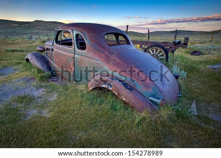 Abandoned car in field at dawn, Bodie Ghost Town, California. - stock photo