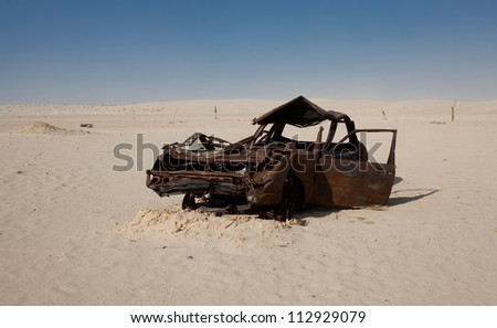 Abandoned Car in Sahara Desert in Tunisia - stock photo