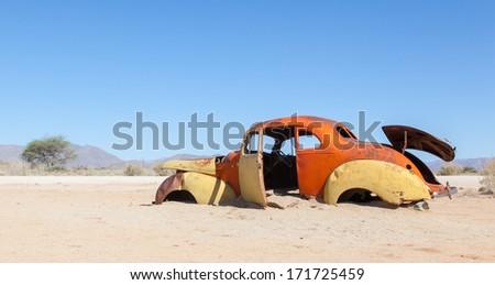 Abandoned car in the Namib Desert, Namibia - stock photo
