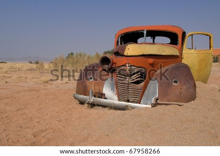 Abandoned car near a service station at Solitaire in the Namib Desert, Namibia - stock photo