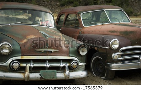 """Abandoned cars in junkyard. """"For Sale"""" - stock photo"""