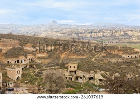 Abandoned cave houses in Cavusin, Cappadocia, Turkey - stock photo
