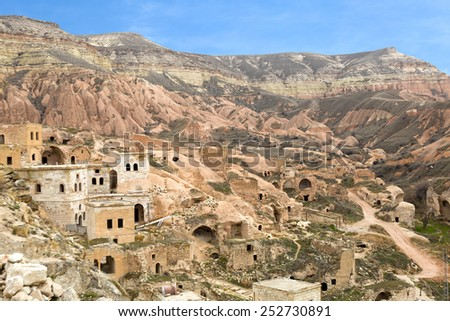Abandoned cave houses in Cavusin town, Cappadocia, Turkey - stock photo