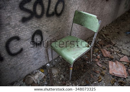 Abandoned chair - stock photo