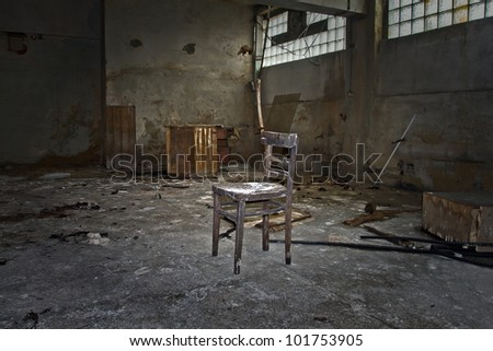 abandoned chair factory in the workshop - stock photo