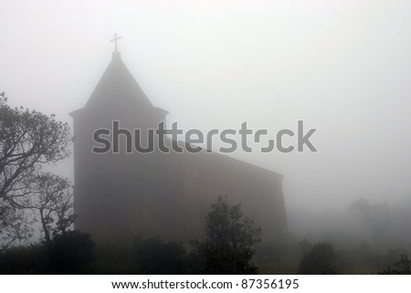 Abandoned church in foggy weather. 'Ghost town' Bokor Hill station near town of Kampot. Cambodia. - stock photo