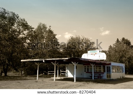 Abandoned classic american drive-in diner restaurant - stock photo
