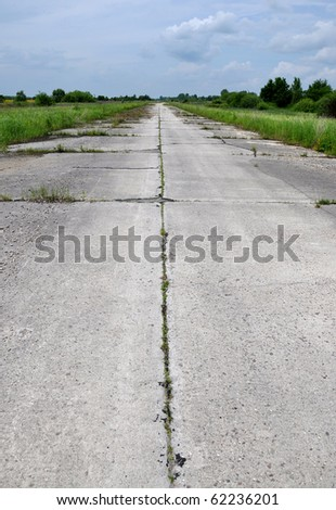 Abandoned concrete road in the dull spring day
