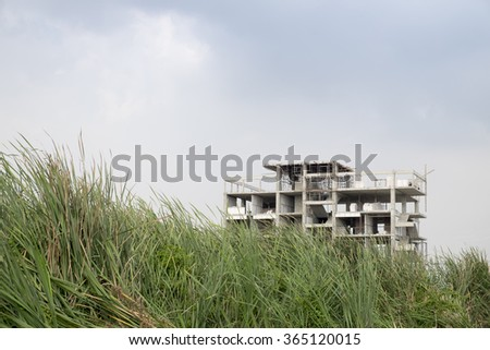 Abandoned Construction Site of Apartment  - stock photo