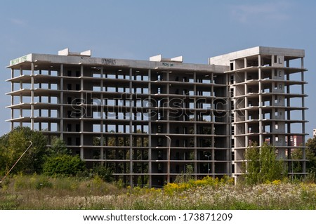 Abandoned Construction Site of Apartment Building - stock photo