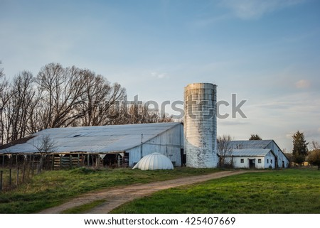 abandoned countryside farm in the afternoon - stock photo