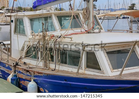 abandoned cover neglected of old wooden boat - stock photo