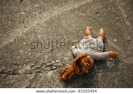 Abandoned Dirty Toy Doll - stock photo