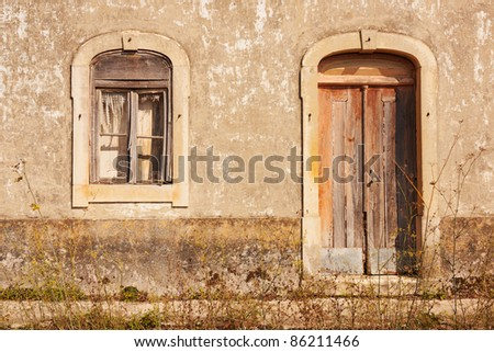 Abandoned facade with wood windows and doors in Portugal - stock photo