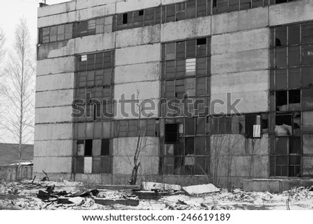 abandoned factory in black and white - stock photo