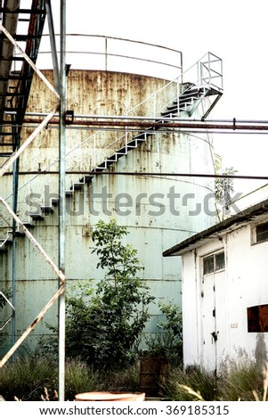 Abandoned factory in industrial zone of Mexico - stock photo