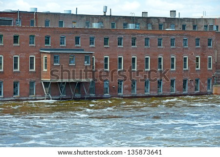 Abandoned factory in rising flood waters - stock photo