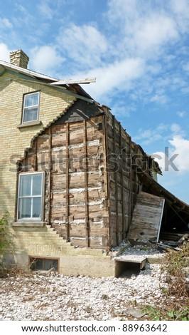 Abandoned farmhouse losing bricks - stock photo