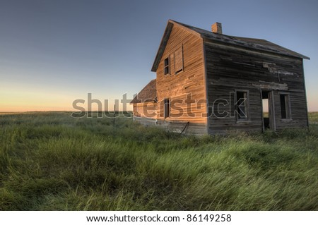 Abandoned Farmhouse Saskatchewan Canada sunset and prairie view - stock photo